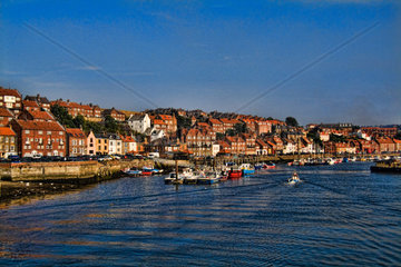 Harbor with fishing boats in the Harbour of beautiful tourist town of Whitby England