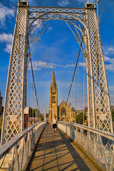 Walking Bridge and the Free Church of Scotland in Inverness Scotland near the home of the Loch Ness Monster