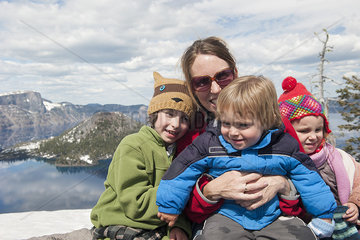 Mother and children at Crater Lake National Park  Oregon  USA