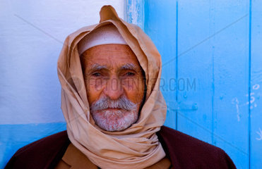 Old local colorful Arab portait of local man in Douz in Sahara Desert of Tunisia Africa