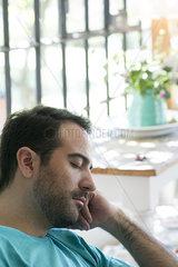 Mand taking nap