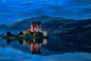 Beautiful Eileen Donan Castle in Western Dornie in Highlands os Scotland the most photographed castle in the world at night with reflections on still beautiful waters