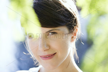 Woman smiling outdoors  portrait