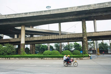 Overpasses  motorbike in foreground  blurred motion