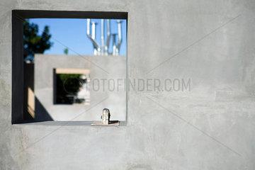 Masonry trowel set on window ledge