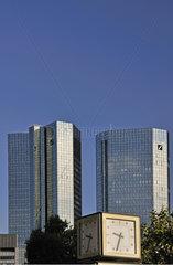 Uhr vor den Deutsche Bank Tuermen in Frankfurt  Highrise Towers of Deutsche Bank in Frankfurt