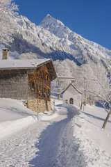 Winter landscape in the Allgaeu with small chapel