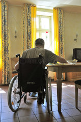 Schlaganfallpatient im Rollstuhl
