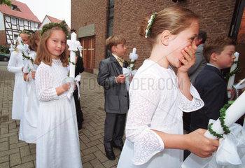 Kinder bei der Erstkommunion  Niedersachsen