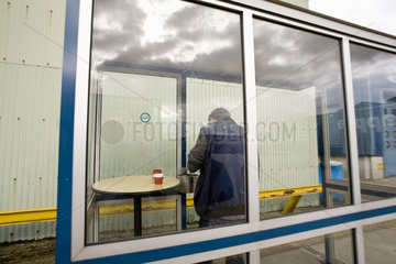 Man in outdoor smoking area