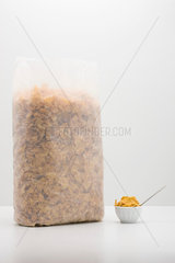 Food concept  cereal bag with small bowl of cereal