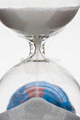 Hourglass  globe in background