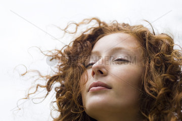 Young woman with eyes closed and serene expression on face  portrait
