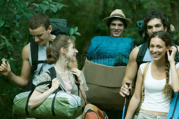 Group of wilderness campers carrying equipment