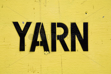 Stenciled lettering on sign reading yarn