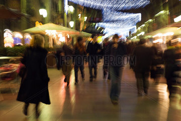 Pedestrians walking on pedestrian street at night  blurred