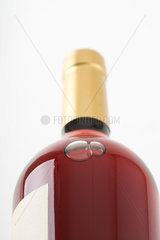 Bottle of rose wine  close-up  low angle view