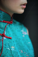 Young woman dressed in traditional Chinese clothing  cropped view of lower face and bust