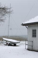 Sailboat ashore in wintery scene