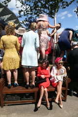 Royal Ascot  Fashion on Ladies Day  women with hats at the racecourse waiting for the Queen