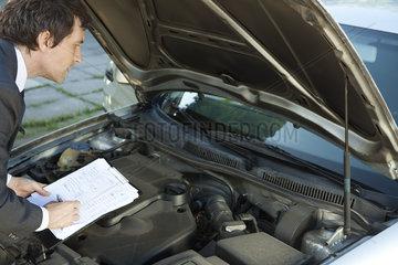 Inspecting car engine