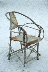 Hand-crafted chair on sand  Zanzibar  Tanzania