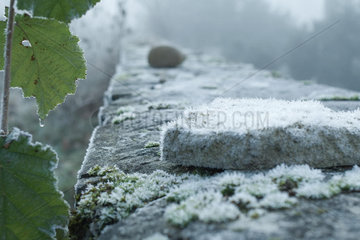 Frost covered stone wall