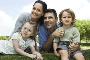 Family relaxing together outdoors  portrait