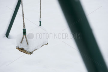 Snow-covered swing