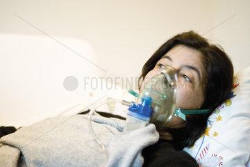 Woman receiving oxygen treatment