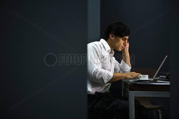 Man in office working late