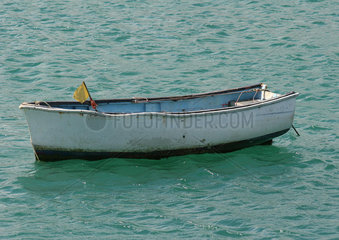 Empty rowboat in water