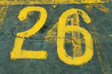 Number 26 painted on asphalt