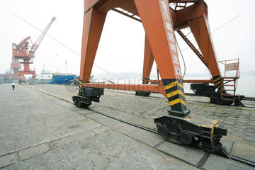 Loading crane on rails in shipyard