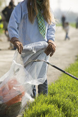 Volunteers cleaning up trash outdoors