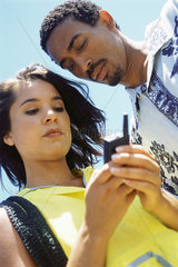 Couple using cell phone  low angle view