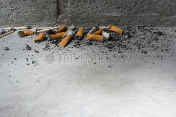 Discarded cigarette butts on ground