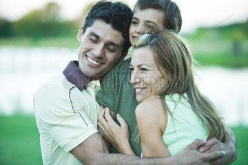 Family having group hug