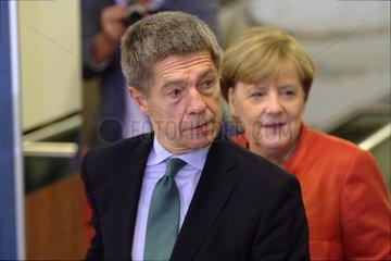 Joachim Sauer und Angela Merkel