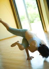 Woman doing sideways crow pose
