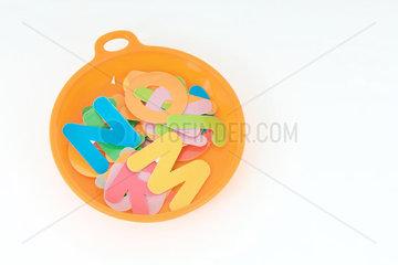 Alphabet letters in plastic dish