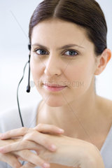 Attentive customer service representative  smiling at camera  portrait