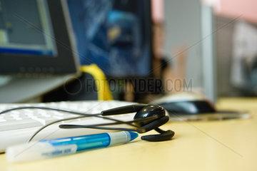 Headset resting on desk