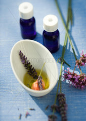 Essential oils and flowers macerating in oil
