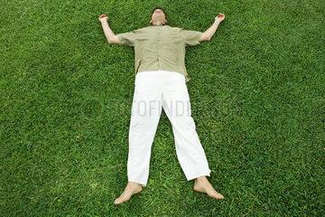 Man lying on grass  full length