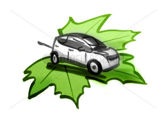 Electric car with electric cable on green leaf