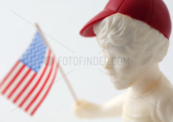 Boy figure holding American flag