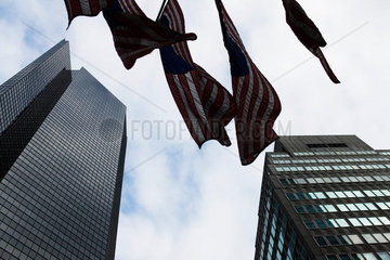 Skyscrapers  flags waiving in breeze  viewed from below