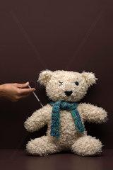 Teddy bear getting a shot