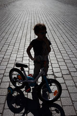 Young boy and his bike